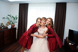 Bride with bridesmaids posing in the