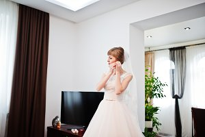 Portrait of a fabulous bride putting