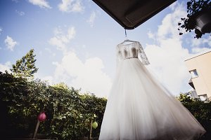 wedding dress hanging on a hanger
