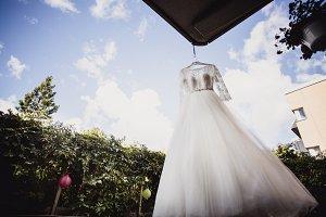 wedding dress hanging on a hanger