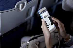woman using smartphone airplane
