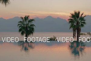 Resort scene at sunset. Swimming