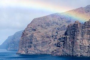 Rainbow over Los Gigantes cliffs