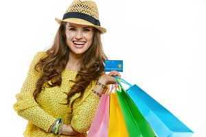 180n Happy woman in hat with shoppin