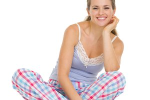 182n Young woman in pajamas sitting