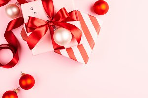 Christmas gifts on pink background