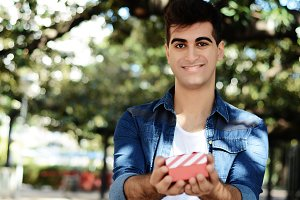 Young arabic man with a red gift box