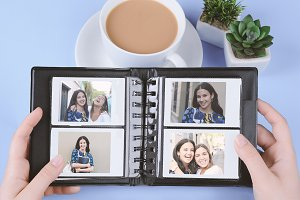Photo album with instant photos of y