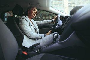 Mature woman driving a car