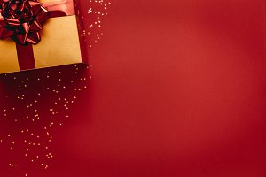 Golden coloured gift box with stars