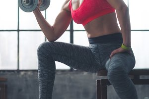 242n Fitness woman lifting dumbbell