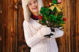 297n Happy woman with Christmas tree