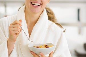 311n Happy young woman in bathrobe e
