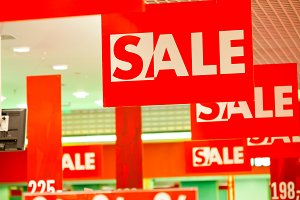 380n Lots of sale signs in clothing