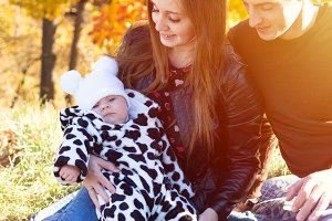 Family with a baby girl in the autum