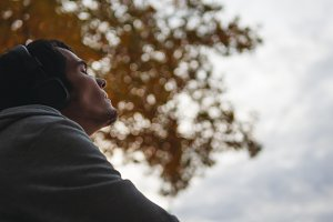 A man enjoys listening to music in h