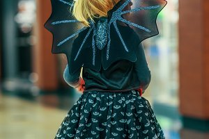 434n modern child in bat costume on