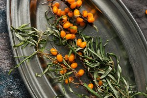 Sea buckthorn berries on a metal bow