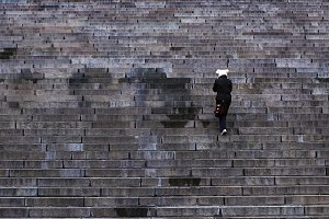 Woman walking up-stairs