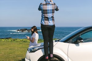 Couple traveling by car photographin
