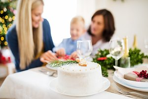 A white a cake on table set for