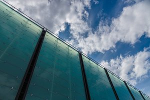 Modern glass building cloudscape