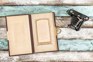 Vintage photo camera and photo album
