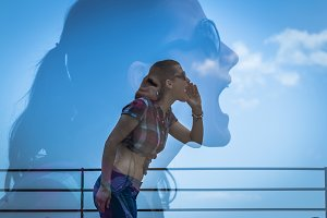Double exposure of young woman shout