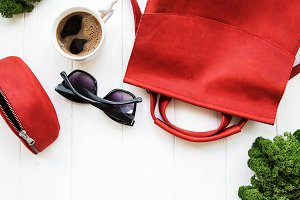 Red leather backpack with  accessori