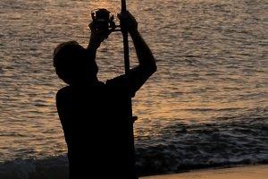 fisherman angler  with rod and reel