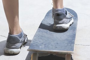 Close-up skateboarder  ready for act