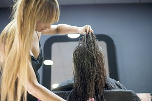 A Hairdresser in action cutting long