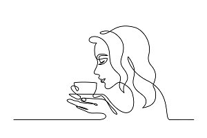 Pretty young woman smelling coffee