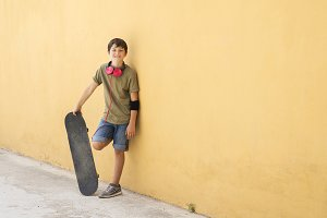 A Teen with skateboard on the city s