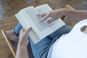 Closeup of a reader reading a book a