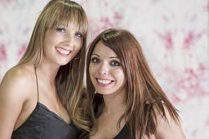 Two women friends laughing with a pe