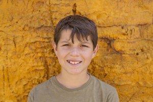 closeup of cute young teen boy smili