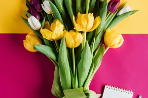 top view of spring tulips with notep
