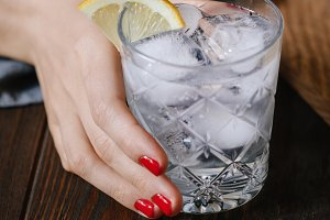 The woman's hand holds the cocktail