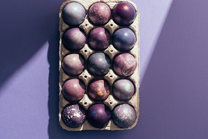 Easter purple eggs in big tray on pu