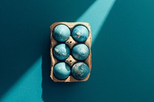 top view of blue easter eggs in tray