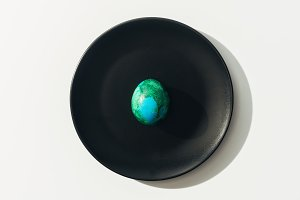 top view of blue and green easter eg