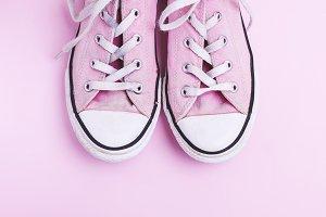 pair of old worn pink sneakers