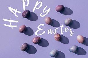painted chicken eggs on purple backg