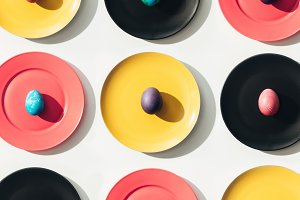 top view of easter eggs on yellow, r