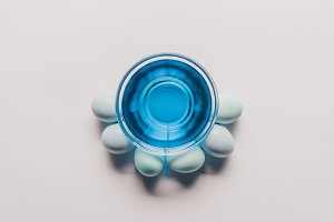 top view of glass with blue paint an