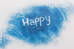 top view of happy sign made of blue