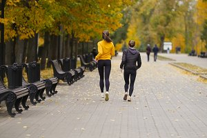 Young fit women running in autumn