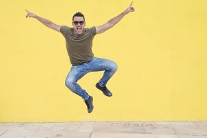 Young man with sunglasses jumping in