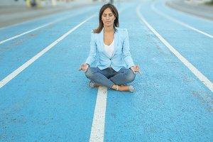 woman meditating yoga in lotus posit